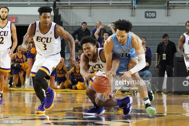 Tulane Green Wave guard Caleb Daniels and East Carolina Pirates forward Jayden Gardner fight for a loose ball during a game between the East Carolina...