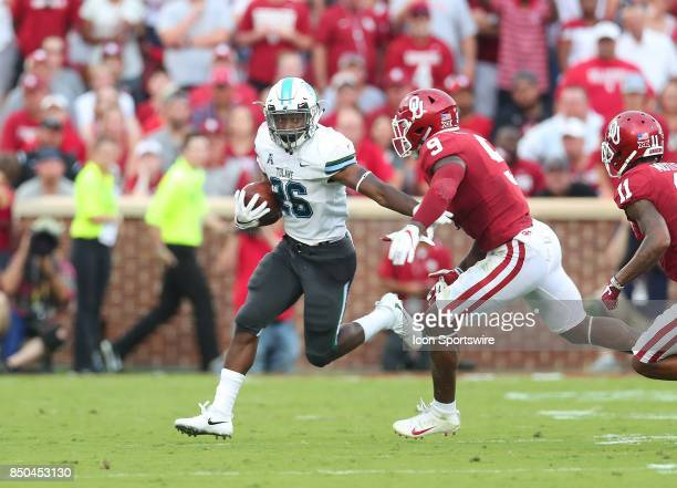 Tulane Green Wave Running Back Dontrell Hilliard runs away from OU defender Oklahoma Sooners LB Kenneth Murray during a college football game between...