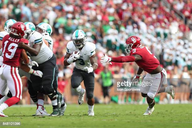 Tulane Green Wave Running Back Sherman Badie runs past Oklahoma Sooners LB Kenneth Murray during a college football game between the Oklahoma Sooners...