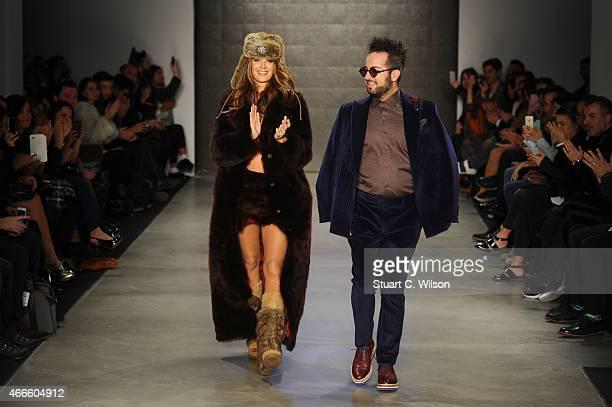Tulin Sahin and designer Emre Erdemoglu walk the runway at the Emre Erdemoglu show during Mercedes Benz Fashion Week Istanbul FW15 on March 17 2015...