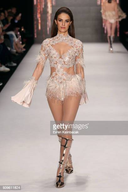 Tulin Sahin walks the runway at the Cihan Nacar show during Mercedes Benz Fashion Week Istanbul at Zorlu Performance Hall on March 29 2018 in...
