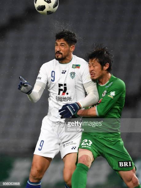 Tulio De Melo of Avispa Fukuoka and Naoya Tamura of Tokyo Verdy compete for the ball during the JLeague J2 match between Tokyo Verdy and Avispa...