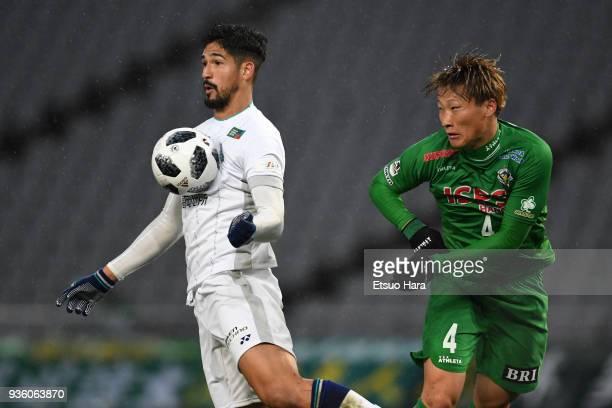 Tulio De Melo of Avispa Fukuoka and Shinnosuke Hatanaka of Tokyo Verdy compete for the ball during the JLeague J2 match between Tokyo Verdy and...
