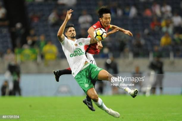 Tulio de Melo of Chapecoense and Yuki Abe of Urawa Red Diamonds compete for the ball during the Suruga Bank Championship match between Urawa Red...