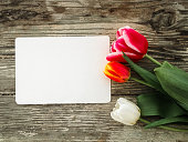 http://www.istockphoto.com/photo/tulips-flowers-bunch-on-dark-barn-wood-planks-background-gm929732014-254935669