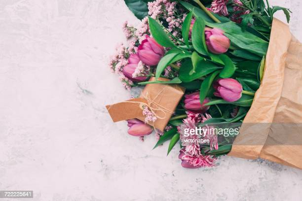 Tulips flowers with wrapped gift box