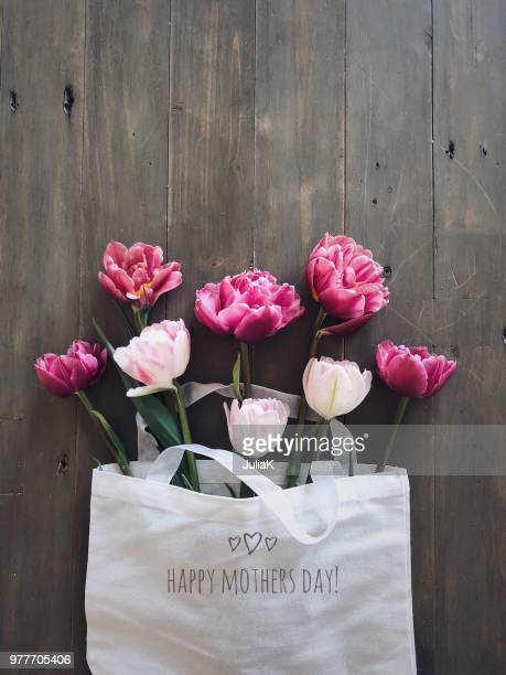 tulips in a mother's day linen bag - mother's day stock pictures, royalty-free photos & images