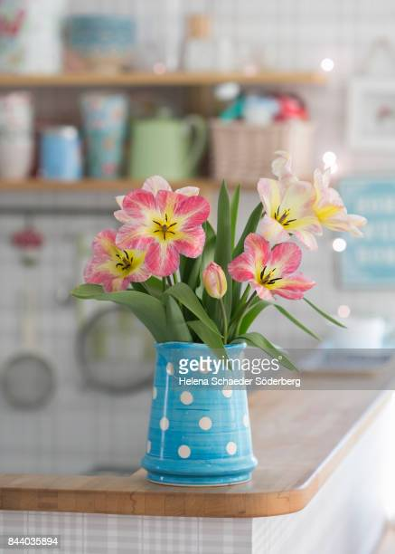 Tulips in polka dotted pitcher