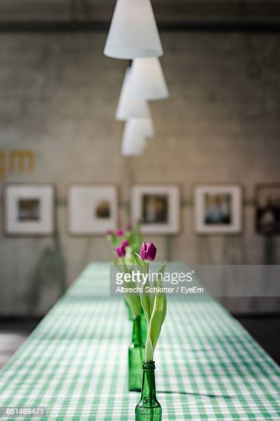 Tulips In Vase On Table At Art Gallery