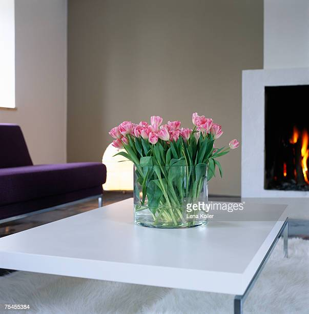 Tulips on a table in a living room.