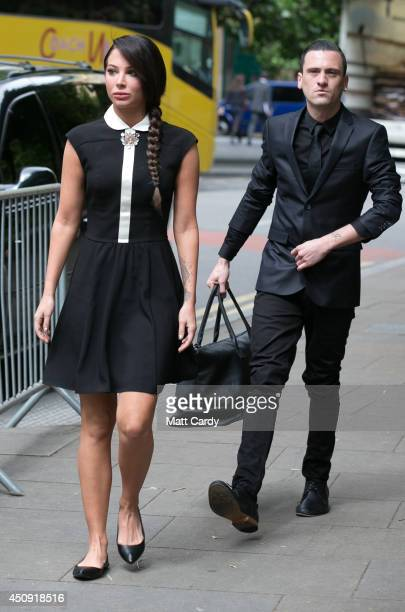 Tulisa Contostavlos and her PA Gareth Varey arrives at Southwark Crown Court on June 20 2014 in London England