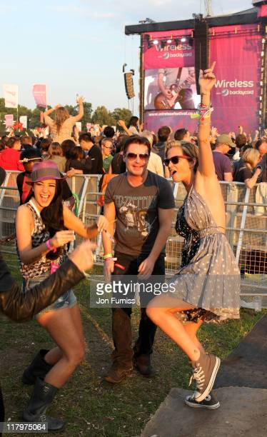 Tulisa Contostavlos Greg Burns and Sarah Harding visit the Barclaycard Unwind VIP Area during Wireless Festival 2011 at Hyde Park on July 2 2011 in...