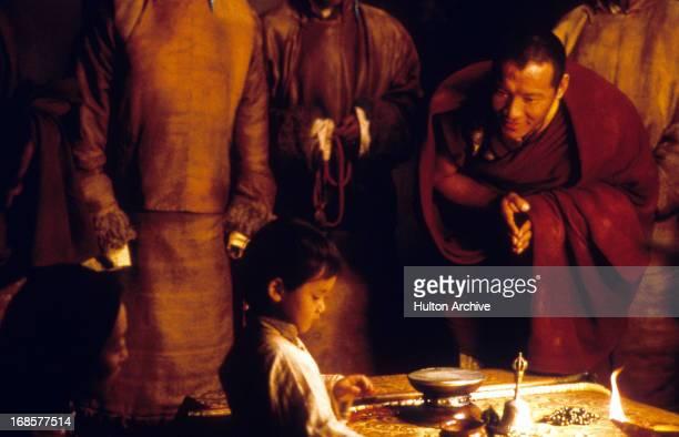 Tulku Jamyang Kunga Tenzin is bowed to in a scene from the film 'Kundun' 1997