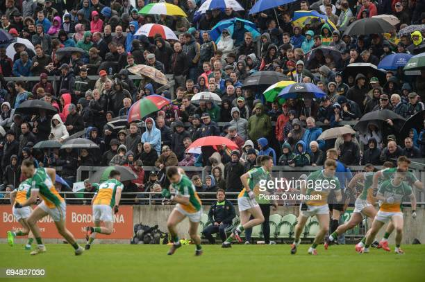 Tullamore Ireland 11 June 2017 Rainsoaked supporters look on as the Offaly players warmup ahead of the start of the second half of the Leinster GAA...