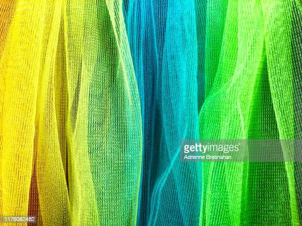 tulle netting in yellow, green, and blue - tulle netting stock pictures, royalty-free photos & images
