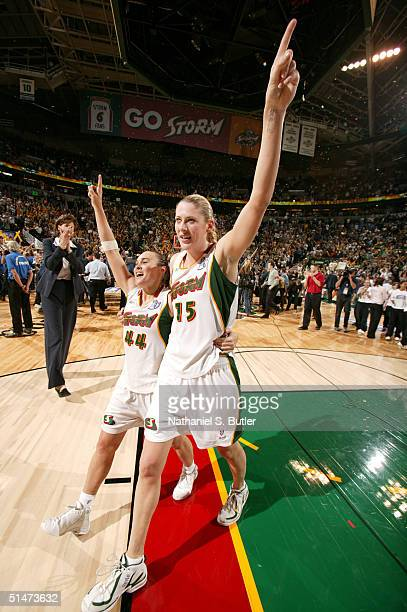 Tully Bevilaqua and Lauren Jackson of the Seattle Storm celebrate after winning the 2004 WNBA Championships against the Connecticut Sun on October...