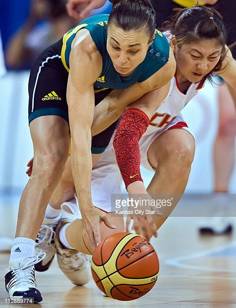 Tully Bevilaqua of Australia left steals the ball from Nan Chen of China in the women's basketball semifinals on Thursday August 21 in the Games of...