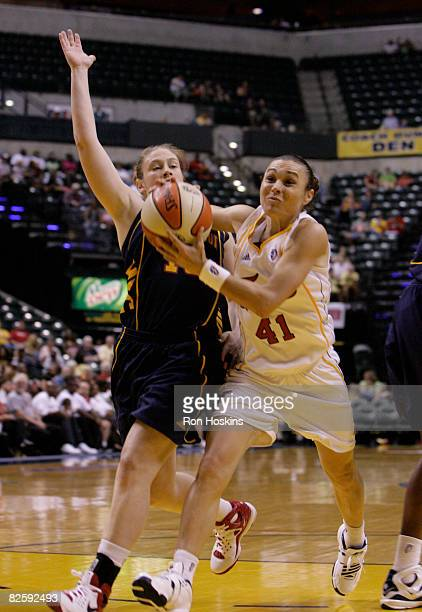 Tully Bevilaqua of the Indiana Fever drives on Lindsay Whalen of the Connecticut Sun at Conseco Fieldhouse on August 28 2008 in Indianapolis Indiana...