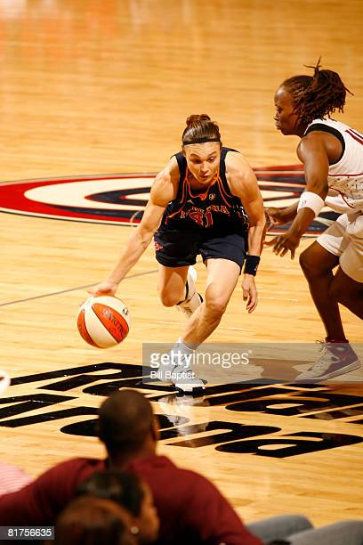 Tully Bevilaqua of the Indiana Fever drives the ball past Shannon Johnson of the Houston Comets at Reliant Arena on June 28, 2008 in Houston, Texas....