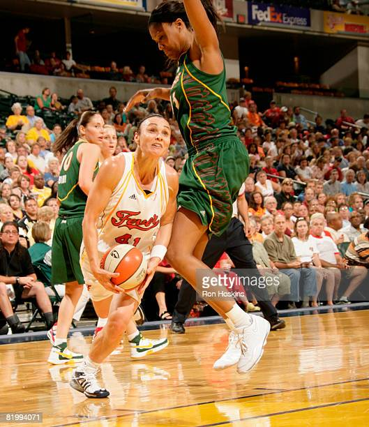 Tully Bevilaqua of the Indiana Fever looks to shoot on Ashley Robinson of the Seattle Storm at Conseco Fieldhouse on July 18 2008 in Indianapolis...