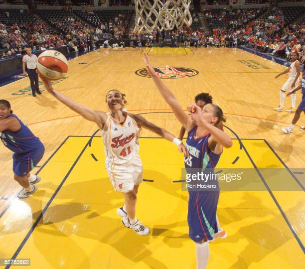 Tully Bevilaqua of the Indiana Fever shoots around Cathrine Kraayeveld of the New York Liberty at Conseco Fieldhouse on September 11 2008 in...
