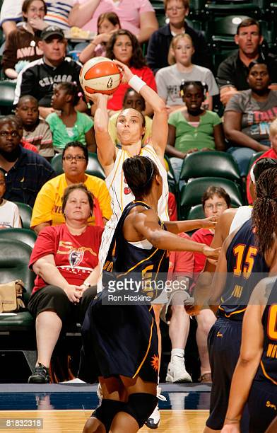 Tully Bevilaqua of the Indiana Fever shoots over a Connecticut Sun defender as the Fever defeated the Sun 8174 at Conseco Fieldhouse on July 5 2008...