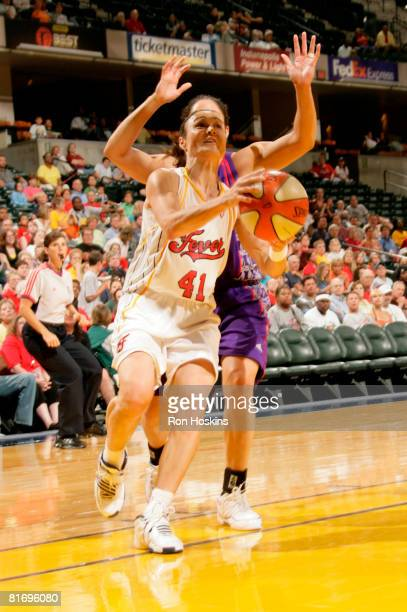 Tully Bevilaqua of the Indiana Fever shoots over a Sacramento Monarch defender at Conseco Fieldhouse June 24 2008 in Indianapolis Indiana The Fever...