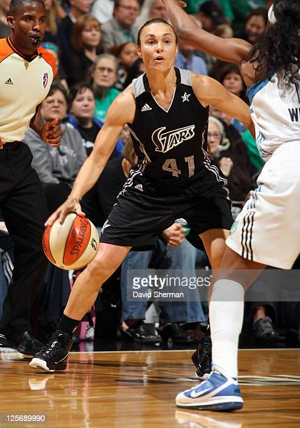 Tully Bevilaqua of the San Antonio Silver Stars looks for the pass against Candice Wiggins the Minnesota Lynx in Game Three of the Western Conference...
