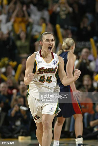 Tully Bevilaqua of the Seattle Storm celebrates after scoring during Game Three of the 2004 WNBA Finals against the Connecticut Sun on October 12...