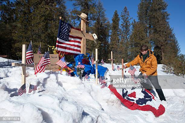 Tully Joe of Twin Falls Idaho places a memento at the site where LaVoy Finicum was shot and killed by federal agents on January 26 approximately 25...
