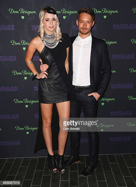Tully Smyth and Simon Hancock attend the Dom Perignon Masquerade Ball At Marquee Nightclub on August 2 2014 in Sydney Australia