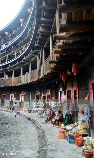 tulou architecture at tianluokeng tulou cluster in nanjing county, fujian province, china - fujian tulou stock pictures, royalty-free photos & images
