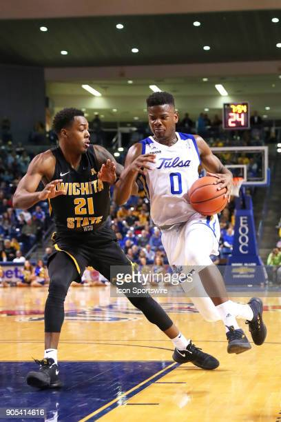 Tulsa Golden Hurricane Forward Junior Etou coming in fast for the shot against Wichita State Shockers Forward Darral Willis Jr during a college...