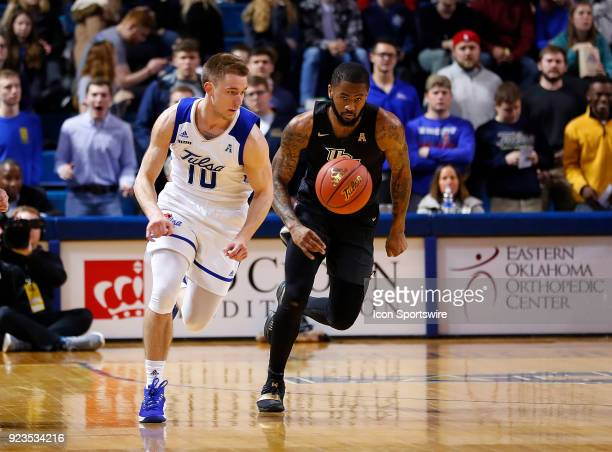 Tulsa Golden Hurricane Guard Curran Scott and Central Florida Guard Dayon Griffin during a college basketball game between the Central Florida...