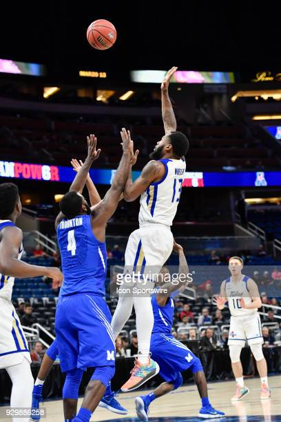 Tulsa guard Jaleel Wheeler shoots over Memphis guard/forward Raynere Thornton during the second half of the AAC Men's Basketball Conference...