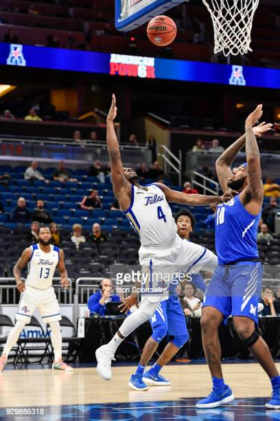 Tulsa guard Sterling Taplin shoots an off balance shot over Memphis forward Mike Parks Jr during the second half of the AAC Men's Basketball...