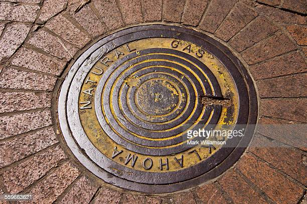 tulsa manhole cover - tulsa stock pictures, royalty-free photos & images