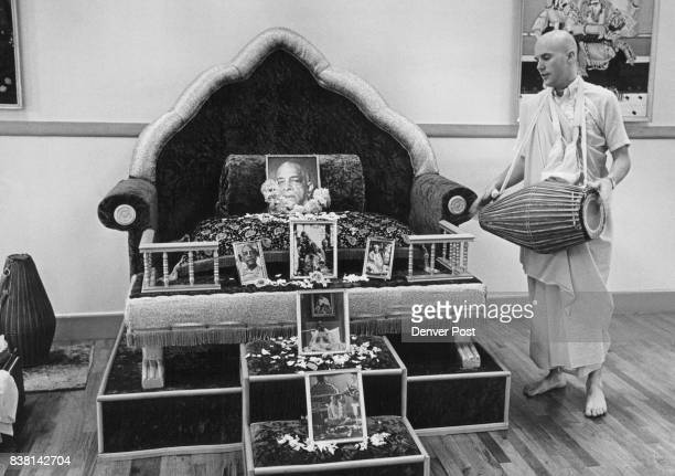 Tulsi Das president of the Denverarea Society of Krishna Consciousness plays Mundranga drums in front of 'throne' for spiritual master who is in the...