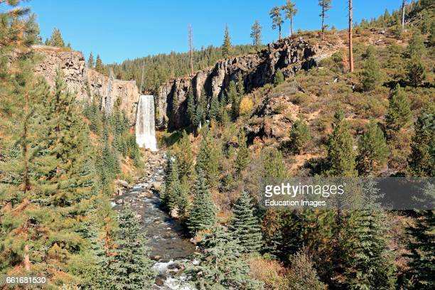 Tumalo Falls drops ninety seven feet in the Deschutes National Forest in the Cascade Mountains near Bend Oregon, Tumalo Falls is on Tumalo Creek...