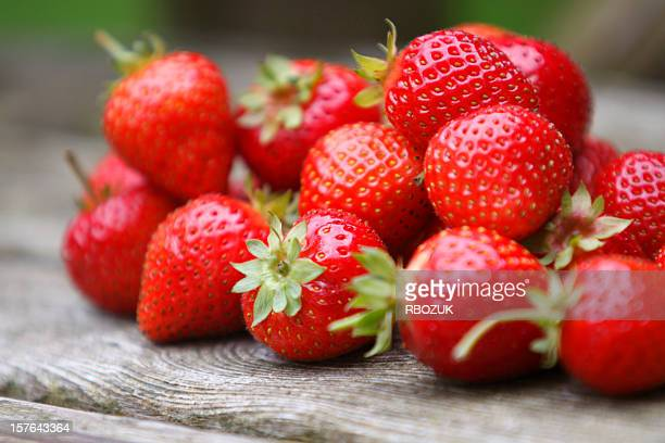 tumble of strawberries - strawberry stock pictures, royalty-free photos & images