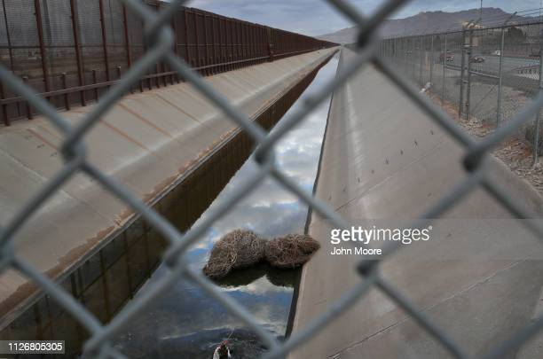 Tumble weeds lie in a canal next to the USMexico border fence on February 01 2019 in El Paso Texas