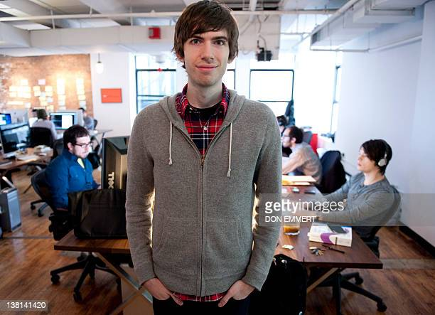 Tumblrfounder David Karp poses for a photo in the headquarters of the microblogging platform and social networking website on February 2 2012 in New...