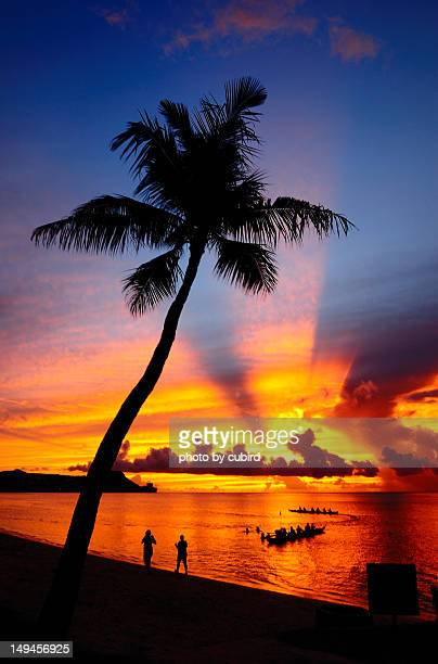 tumon bay-sunset - guam stock pictures, royalty-free photos & images