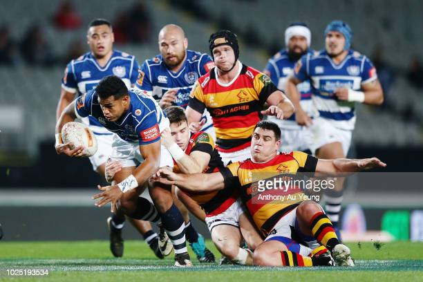 Tumua Manu of Auckland on the charge against Dwayne Sweeney of Waikato during the round 13 Mitre 10 Cup match between Auckland and Waikato at Eden...
