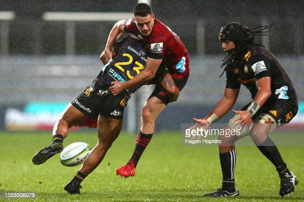 Tumua Manu of the Chiefs tackles Will Jordan of the Crusaders during the round 3 Super Rugby Aotearoa match between the Crusaders and the Chiefs at...