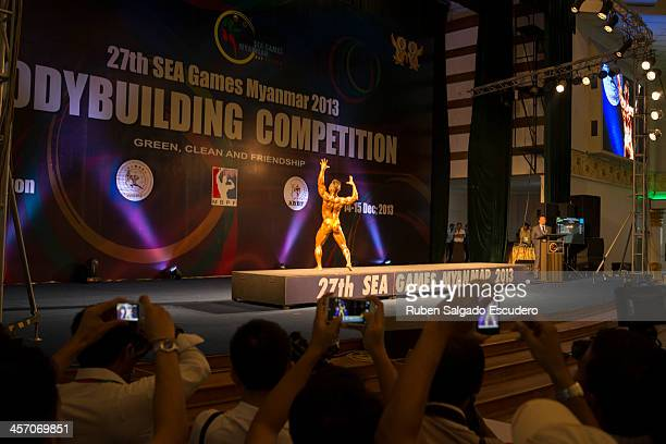Tun Min of Myanmar competing during the 55kg category bodybuilding contest at the Myanmar Convention Center during the 2013 SEA Game on December 14...