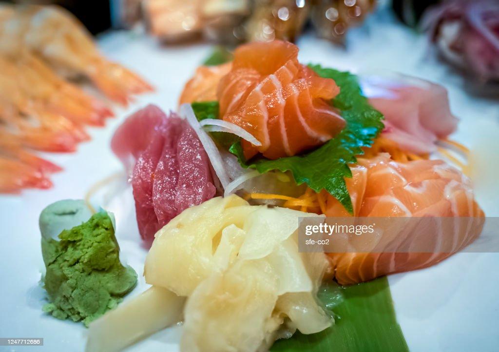 Tuna and salmon sashimi (foreground; raw fish meat) : Stock Photo