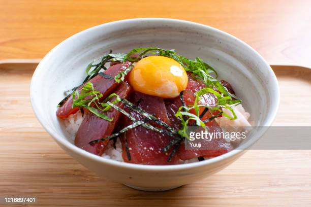 tuna pickled rice bowl is a typical japanese dish. we make tuna sashimi put on soy sauce on sushi rice. if you like, put raw eggs. - shiso stock pictures, royalty-free photos & images