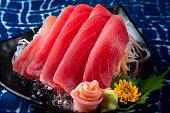 Tuna sashimi slice cutting.