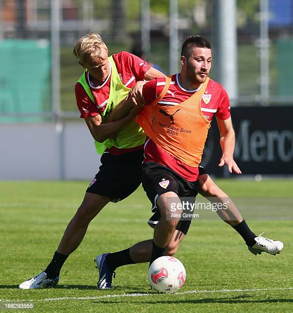 Tunay Torun 8front is challenged by Michael Vitzthum during a VfB Stuttgart training session at the club's premises on May 8 2013 in Stuttgart Germany
